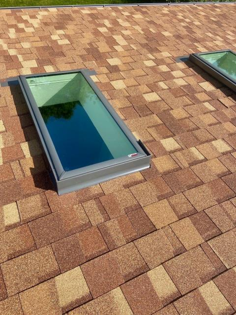 Longmont, CO - A new roof and new skylights were in order for this roof in Longmont.  The shingles you see here are CertainTeed Northgate Class IV Impact Resistant shingles in the color Resawn Shake.