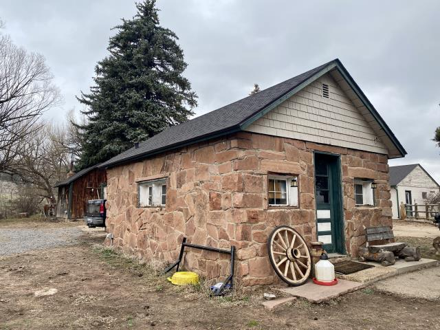 Lyons, CO - The roof that we installed on this old building as part of the re-roofing of several buildings on an old homestead site in Lyons, is a CertainTeed Landmark roof in the color Black Walnut.