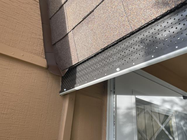 Lyons, CO - Gutter screens are becoming a more and more popular option when we are installing new gutters on a house, like the ones you see here on a roof/gutter job we completed in the Raymond/Randall area up in the mountains.