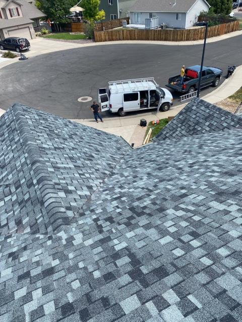 Mead, CO - Here's a shot of the crew finishing up a roof in Mead.  The shingles we installed are CertainTeed Northgate Class IV Impact Resistant shingles in the color Granite Gray.