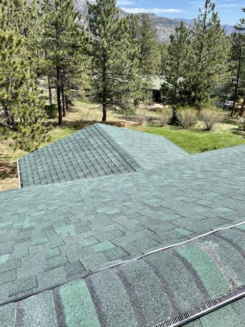 Lyons, CO - Hunter Green is the color of this CertainTeed Landmark roof that we installed in Pinewood Springs.  Look at the clear skies in the background!  Hoping they look like that again soon!