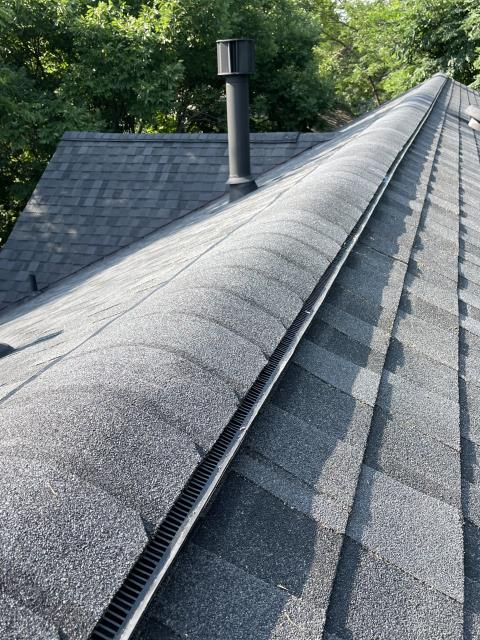 Longmont, CO - Moire Black is the color of these CertainTeed Northgate Class IV Impact Resistant shingles that we installed on this roof in Niwot.  The homeowner also had us add ridge vent to help better ventilate the attic.
