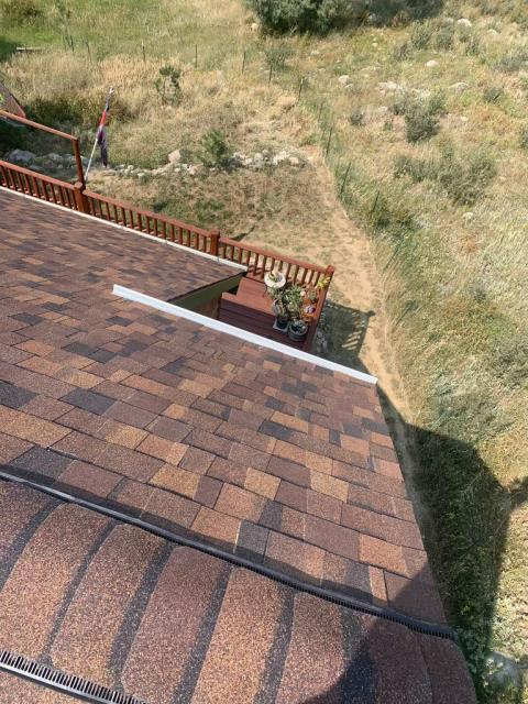 Drake, CO - That's one steep roof!  This roof was in need of replacement due to hail damage up on Storm Mountain outside of Drake.  We installed a new CertainTeed Northgate Class IV Impact Resistant roof in the color Burnt Sienna.