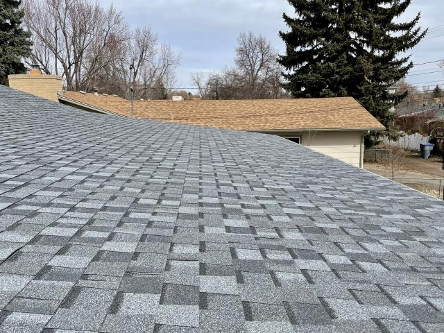 Longmont, CO - On low slope areas where shingles are installed on a patio like this one in Longmont, we install water and ice barrier underneath to be sure there will never be a leak.  The gorgeous shingles you see here are CertainTeed Northgate Class IV Impact Resistant Shingles in the color Pewter.