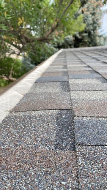 Longmont, CO - The crew was getting up close and personal with the CertainTeed Northgate Class IV Impact Resistant shingles that they installed today on a roof in Longmont.  The roof needed to be replaced due to hail damage.