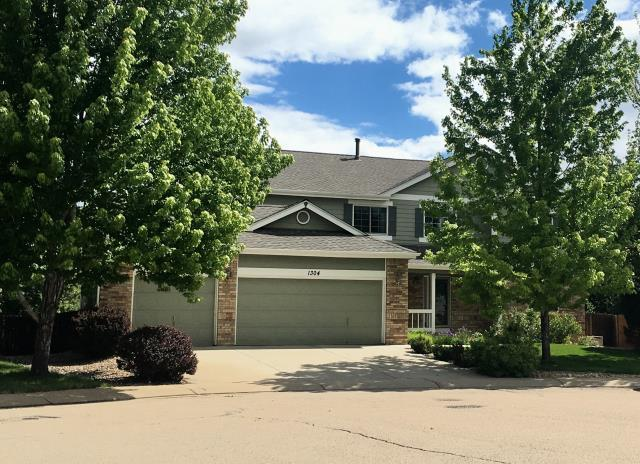 Longmont, CO - The Weathered Wood colored shingles that we installed on this roof from the GAF Timberline HD line of shingles, compliment the paint colors of the siding on this house really nicely.