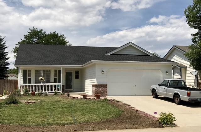 Johnstown, CO - We have done a lot of work in Johnstown lately due to the hailstorm there back a month or two ago.  This is one of the roofs we have done there recently.  The customer chose Charcoal colored shingles from the GAF Timberline HD line of shingles to accent the white paint.  Looks great!