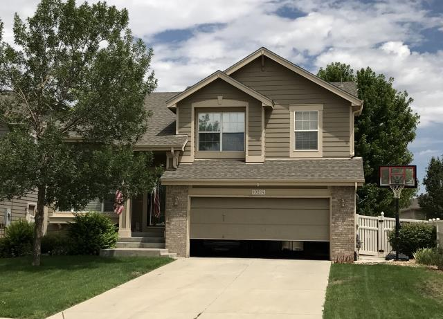 Firestone, CO - This home in Firestone was roofed in Weathered Wood colored shingles - the most popular color on the market.  The shingles are from the GAF Timberline HD line of shingles.