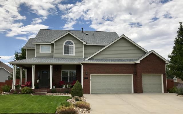 Frederick, CO - This home in Frederick looks so nice with it's new roof!  The shingles are from the GAF Timberline HD line of shingles and the color of the shingles is Birchwood.