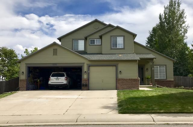 Erie, CO - We have been doing a lot of work in Erie lately.  This house is one example of a new roof that we installed in Erie recently.  This customer chose Slate colored shingles - they go so well with the paint colors on this home.  The shingles are GAF Timberline HD shingles.