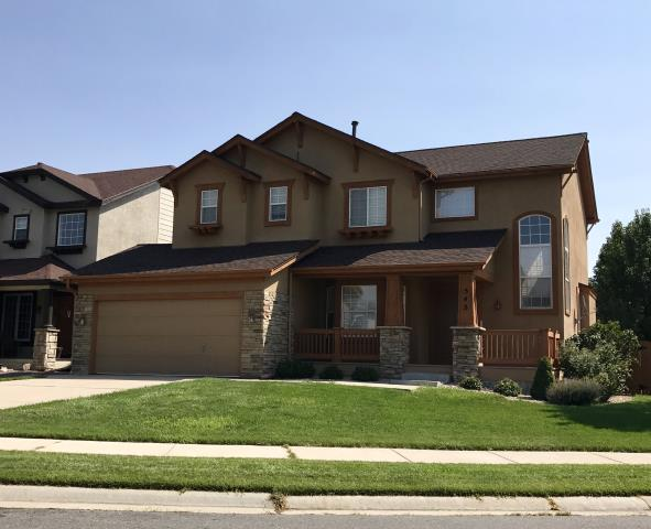 Erie, CO - We work in different areas in sprees it seems like.  We have done a lot of work in Erie lately where this house is located.   We re-roofed this house with Hickory GAF Timberline HD shingles.