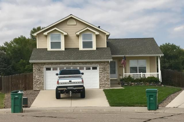 Evans, CO - This house that we roofed in Evans has one incredible roof system on it.  We used Weathered Wood GAF Timberline HD shingles, GAF Weather Watch water and ice shield on the eaves, and we upgraded the ventilation with GAF Cobra Ridge Vent.