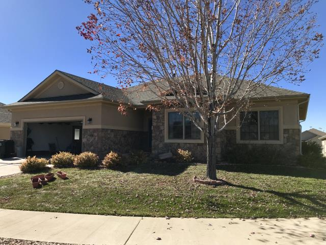 Greeley, CO - We re-roofed this home in Greeley that had a hail damaged roof.  The shingles we installed are GAF Timberline HD shingles and the color is Weathered Wood.