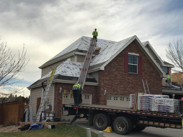 Fort Collins, CO - This is one steep roof!  We just finished this roof yesterday and because of the size, and the steepness, it took a little longer than the average roof.  This picture shows the roof being loaded by our material supplier.  You can see the roof has been prepped with GAF TigerPaw underlayment and GAF Weather Watch Water and Ice Shield.  Scott said this roof was hard on his ankles.  :)