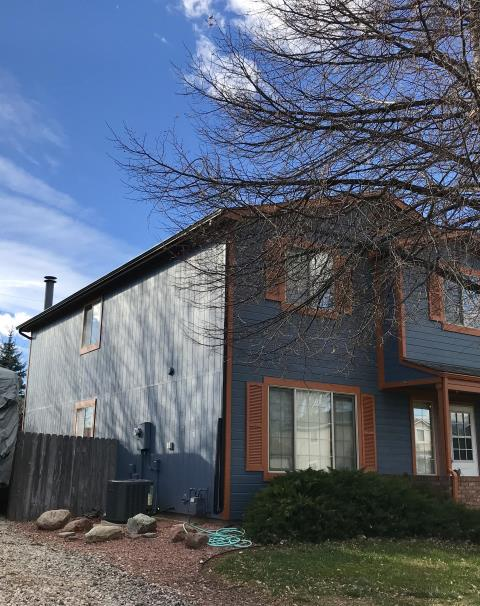 "Fort Collins, CO - We installed new 5"" aluminum seamless gutters and new downspouts on the two story sections of this home.  They wanted a ""color change"", so they chose black gutters and downspouts."