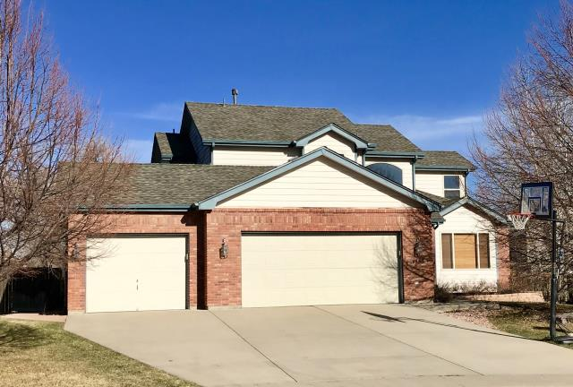 Fort Collins, CO - We just re-roofed this home in Fort Collins and the roof is getting a good test today with a fresh fallen snow!  The shingles we installed are GAF Timberline HD shingles in the color Weathered Wood.  Weathered Wood is the most popular GAF color on the market.