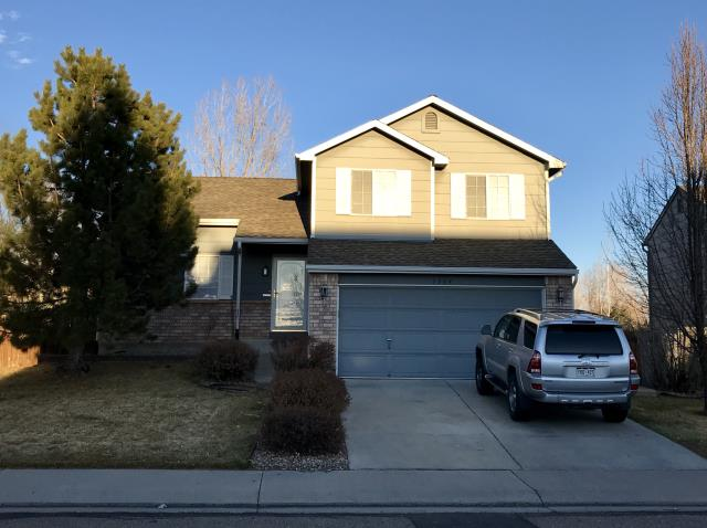 Longmont, CO - Took this picture at the end of the day - but you can still see some of the roof.  This is a rental home in Longmont that we roofed.  The owner had us roof her own home as well.  The shingles we installed are GAF Timberline HD shingles and the color is Weathered Wood.