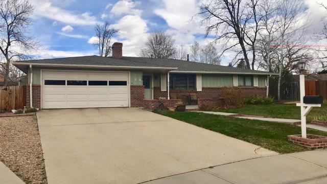 Longmont, CO - This home in Longmont was re-roofed by us using GAF Timberline HD shingles in the color Weathered Wood.