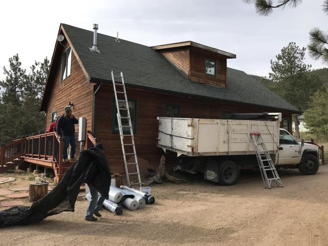 Lyons, CO - We are working up in Pinewood Springs today.  The crew is tarping and unloading - getting ready to tear off the old 3Tab shingles on this roof and install new GAF Timberline HD shingles.  The color we will be installing is Hunter Green.