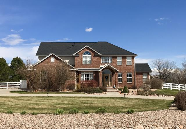 Mead, CO - This is a house we roofed right near us in Mead.  Love working local!  We installed GAF Timberline HD shingles in the color Charcoal.  Looks really nice!
