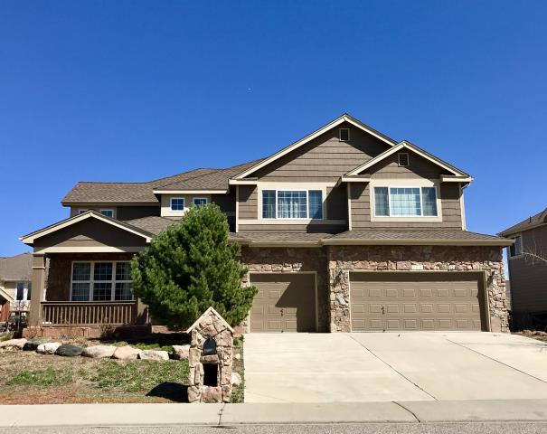 Longmont, CO - We just re-roofed this house in Longmont before the winds set in.  We used GAF Timberline HD shingles in Barkwood.