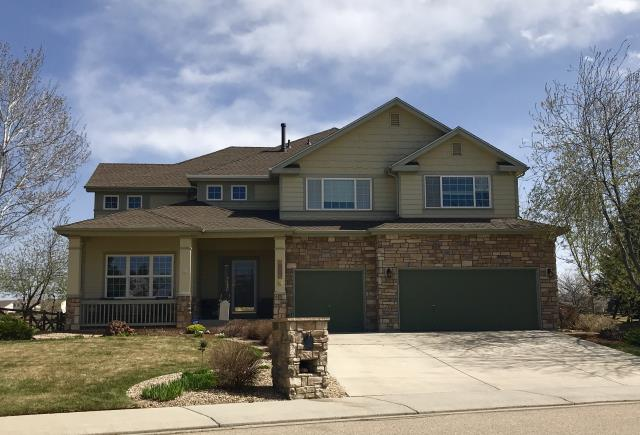 Longmont, CO - Just re-roofed this house in Longmont.  The shingle we installed are GAF Timberline HD shingles in Barkwood.