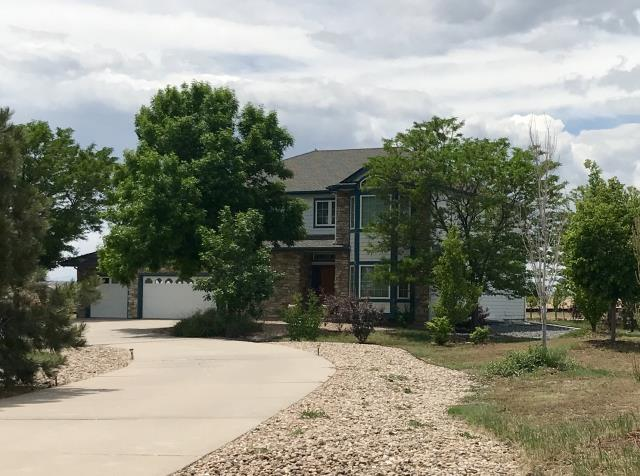 Thornton, CO - This is a house in Thornton that we recently re-roofed.  The shingles we installed are GAF Timberline HD shingles in the color Weathered Wood.  We also installed new gutters and downspouts for this customer.