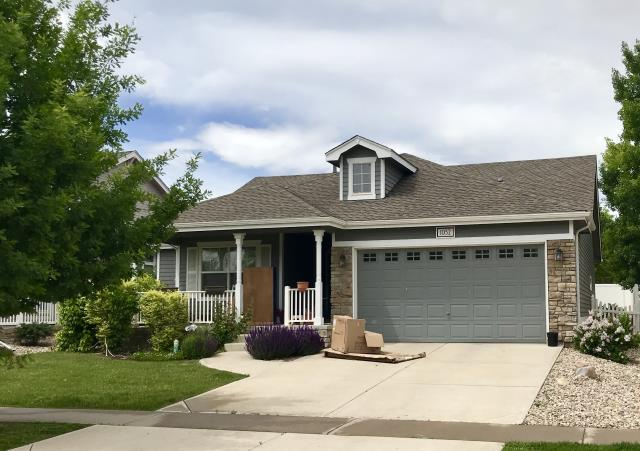 Windsor, CO - This house in Windsor is the last of four houses roofed by us all right next to each other for one owner.  We used GAF Timberline HD shingles in Weathered Wood on this home.