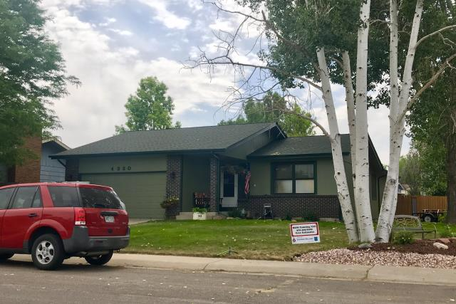 Greeley, CO - We re-roofed this house in Greeley with GAF Timberline HD shingles in the color Hunter Green.