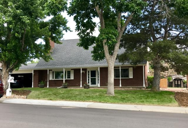 Longmont, CO - We re-roofed this house in Longmont using GAF Timberline HD shingles in the color Pewter Gray.  The shingle color compliments the brick and trim so nicely.