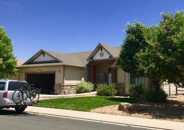 Fort Collins, CO - This home up in Fort Collins is roofed with GAF Timberline HD shingles in the color Weathered Wood.