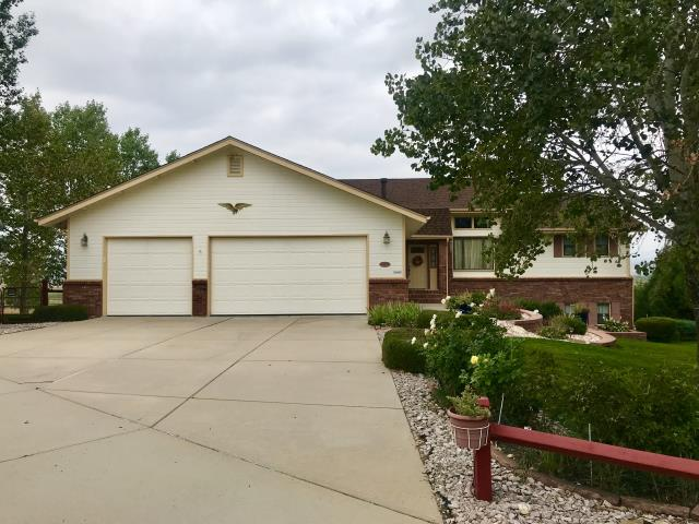 Loveland, CO - This is a home in Loveland that we just recently re-roofed due to wind damage.  We installed GAF Timberline HD shingles in the color Hickory.