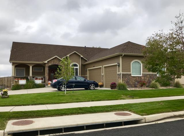 Frederick, CO - This is a home in Frederick - one of many, that we have recently re-roofed due to hail damage.  The shingles we installed are GAF Timberline HD shingles in the color Barkwood.