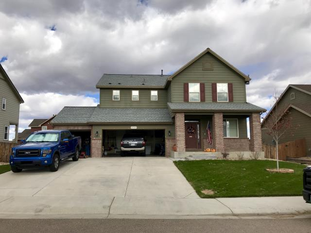 Frederick, CO - We are working in Frederick today roofing another home hit with hail.  This one in Frederick was re-roofed by us due to hail damage using GAF Timberline HD shingles in the color Birchwood.