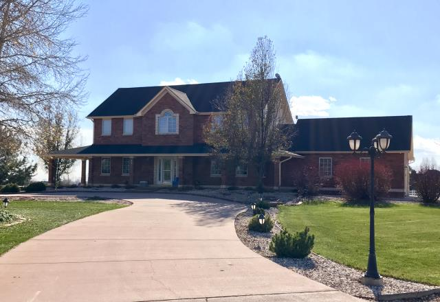 Mead, CO - The Charcoal GAF Timberline HD shingles we just installed on this house in Mead, go so well with the brick on this home.