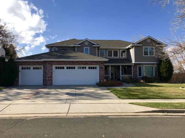Longmont, CO - This home in Longmont was re-roofed recently by us due to hail damage.  We installed GAF Timberline HD singles in the color Weathered Wood.