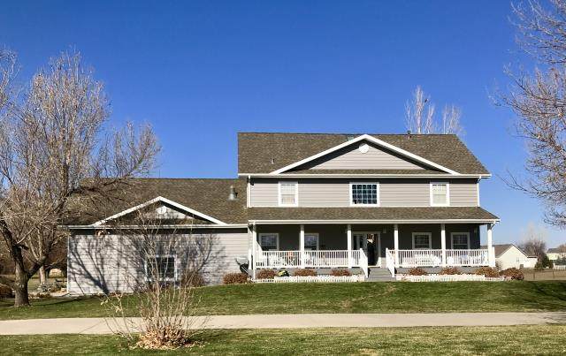 Mead, CO - We re-roofed this home in Mead for a second time this past fall.  The first time we re-roofed it, it was just getting old and they needed a new roof.  The second time it was due to hail damage.  We installed GAF Timberline HD shingles in the color Weathered Wood.