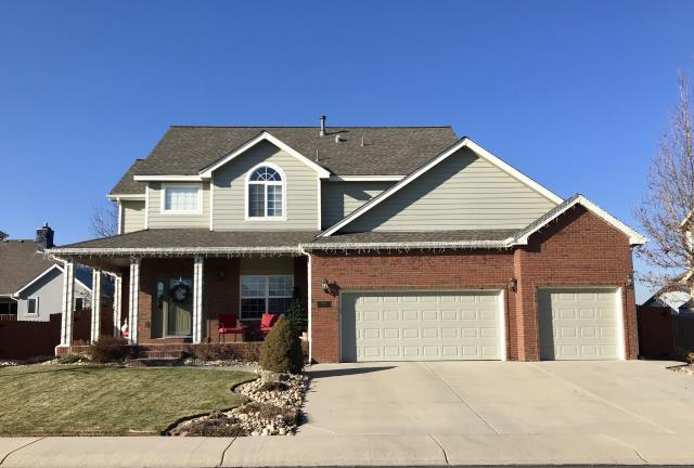 Frederick, CO - This is the second time we re-roofed this home in Frederick.  The first time due to age and the second time due to hail damage.  We installed GAF Timberline HD shingles in the color Weathered Wood.