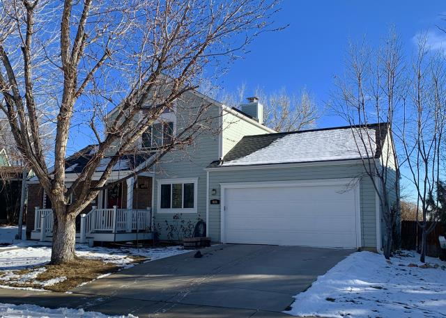 Louisville, CO - This is a home in Louisville that we re-roofed using GAF Timberline HD shingles in the color Pewter Gray.  You can see a few of them peaking out from under the snow...