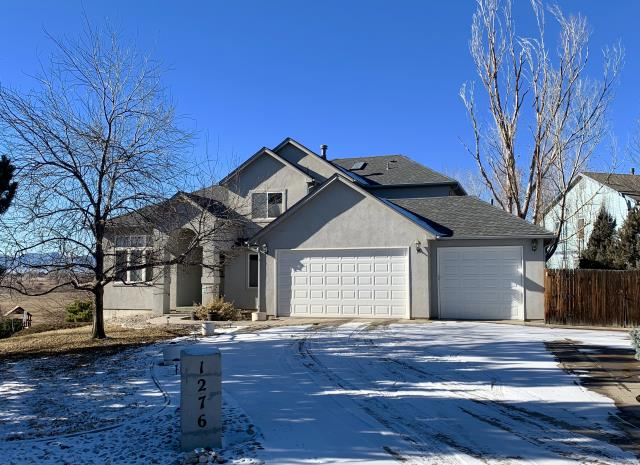 Erie, CO - Pewter Gray was a great color choice for this home in Erie.  We installed GAF Timberline HD shingles on this hail damaged roof.