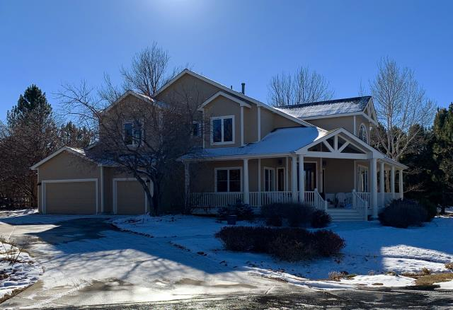 Longmont, CO - This snow covered roof in Niwot is protected with a GAF Timberline HD Ultra shingle roof system in the color Weathered Wood.  Timberline HD Ultras are a thicker shingle than the standard Timberline shingles.