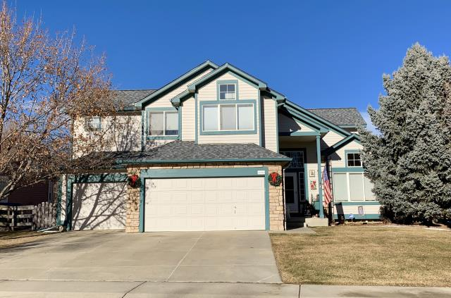 Longmont, CO - This house in Longmont was re-roofed using GAF Timberline HD shingles in the color Pewter Gray.