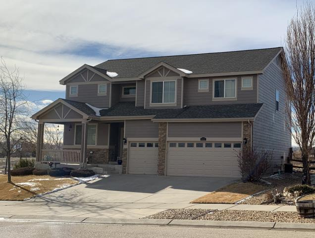 Mead, CO - We have roofed this home in Mead twice now.  Both times it was due to hail damage.  The shingles we installed are GAF Timberline HD shingles in the color Weathered Wood.