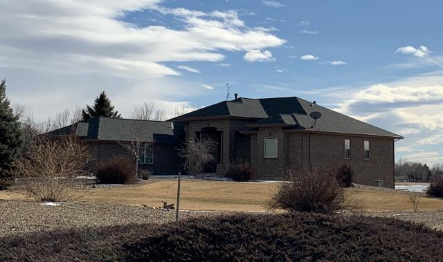 Mead, CO - We recently re-roofed this house in Mead using GAF Timberline HD shingles in the color Slate.