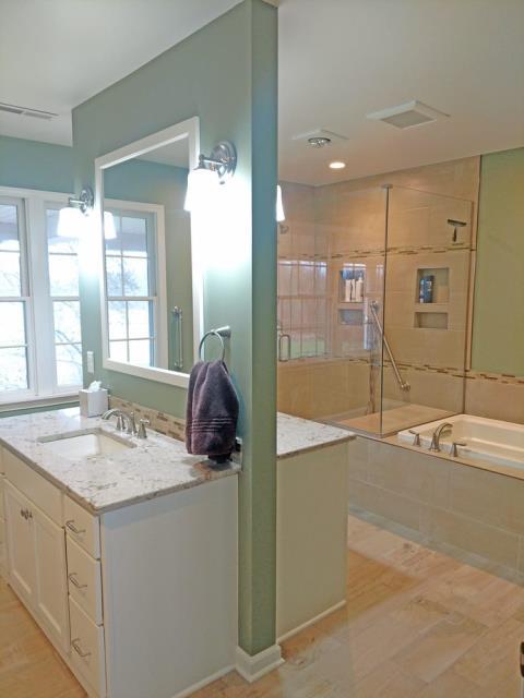 Marne, MI - A beautiful open, master bathroom remodel receiving lots of natural light!