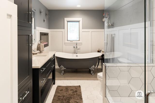 Walker, MI - Elegant new bathroom remodel featuring a fireplace and clawfoot bathtub.