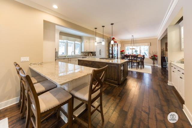 Cannon Township, MI - Open new kitchen remodel with hanging lights, accessible island, and space for the whole family!