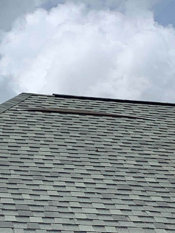 Saint Rose, LA - Looking at customers roof for storm damage
