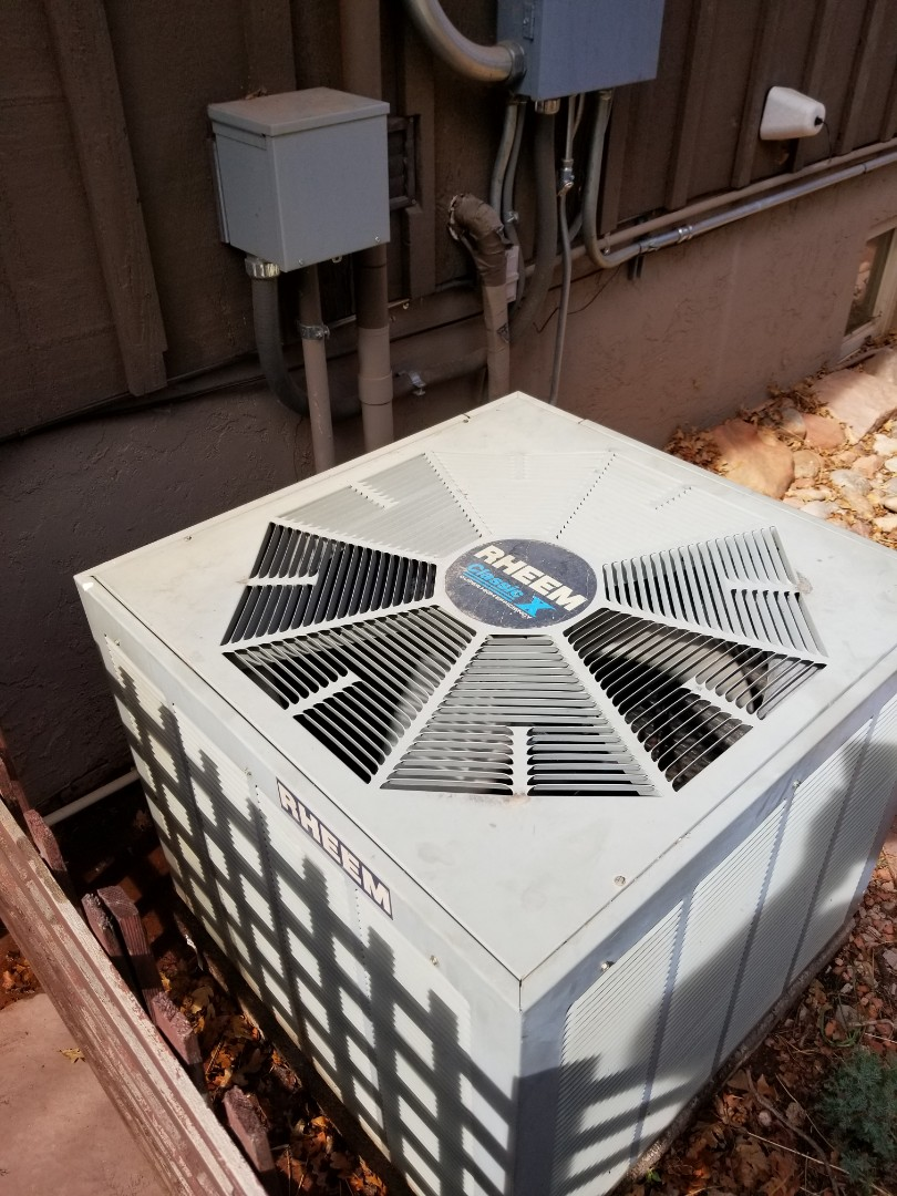 Manitou Springs, CO - Air conditioner service on Rheem coil and condenser. Also service Aprilaire air purifier.