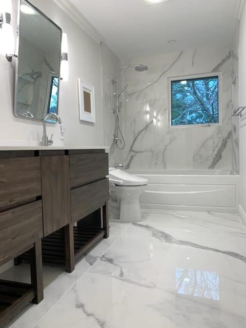 Syosset, NY - Masterful tile work on this full bathroom remodel by the Elite Bathrooms team! Beautiful design and layout!